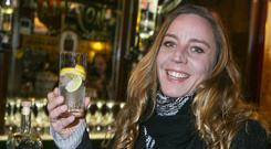 Cheers: Carene Lecaille from Normandy is pictured enjoying a Dingle Gin in the Merchant O'Shea's Bar in Dublin. Picture: Kyran O'Brien