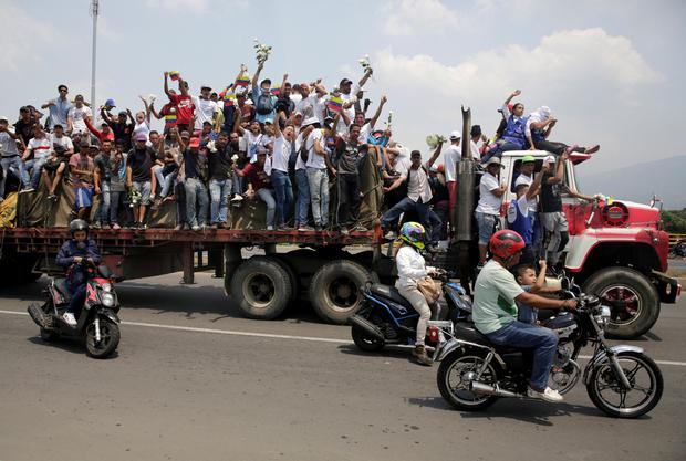 Venezuela's opposition supporters wave from a truck carrying humanitarian aid for Venezuela, near of the border line, on the outskirts of Cucuta, Colombia February 23, 2019. REUTERS/Marco Bello
