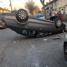 Finglas fire station were called to a car on it's roof and collision with nearby cars this evening. Photo: Dublin Fire Brigade