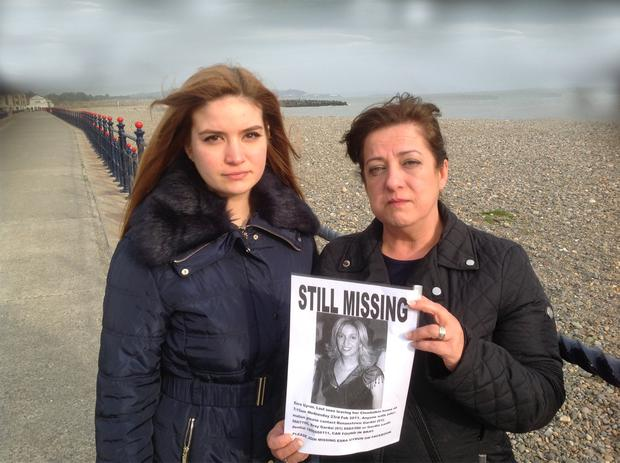 Esra's sister, Berna Fidan, and Berna's daughter, Ayda, in Bray, holding a new missing person poster appealing for information on the wherabouts of Esra Uyrun