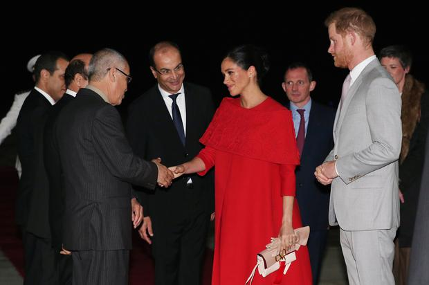 Britain's Prince Harry and Meghan, Duchess of Sussex, are welcomed by officials at the Casablanca Airport in Casablanca, Morocco, February 23, 2019. REUTERS/Hannah McKay/Pool