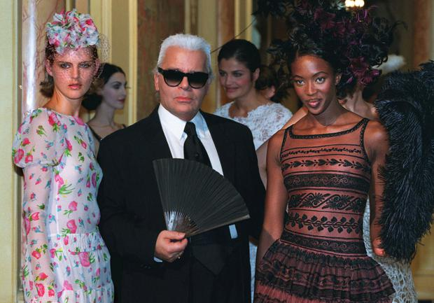HIGH FASHION: Top British models Naomi Campbell, right, and Stella Tennant pose with Karl Lagerfeld after he presented his Chanel collection in January 1997