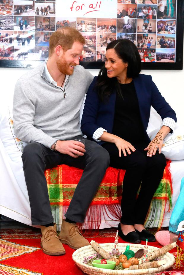 Prince Harry, Duke of Sussex and Meghan, Duchess of Sussex during a Henna ceremony as they visit the