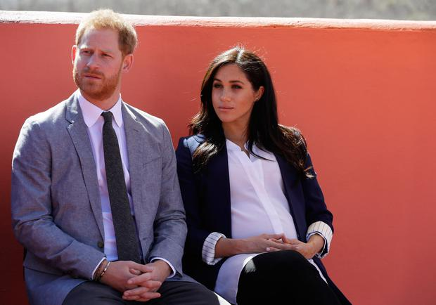 Prince Harry, Duke of Sussex and Meghan, Duchess of Sussex attend an Investiture for Michael McHugo the founder of 'Education for All' with the Most Excellent Order of the British Empire on February 24, 2019 in Asni, Morocco