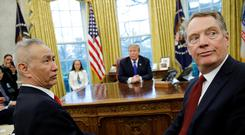 China's Vice Premier Liu He turns with U.S. Trade Representative Robert Lighthizer during a meeting with U.S. President Donald Trump in the Oval Office at the White House in Washington, U.S., February 22, 2019. REUTERS/Carlos Barria/File Photo