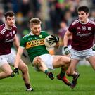 Peter Crowley of Kerry in action against Johnny Duane, left, and Barry McHugh of Galway during the Allianz Football League Division 1 Round 4 match between Galway and Kerry at Tuam Stadium in Tuam, Galway. Photo by Stephen McCarthy/Sportsfile