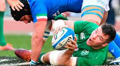 Ireland's flanker Peter O'Mahony passes the ball during the Six Nations international rugby union match between Italy and Ireland at the Olympic stadium in Rome (Photo by Vincenzo PINTO / AFP)VINCENZO PINTO/AFP/Getty Images