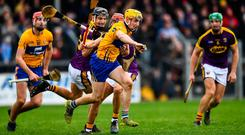 Rory Hayes of Clare is tackled by Paul Morris of Wexford during the Allianz Hurling League Division 1A Round 4 match between Clare and Wexford at Cusack Park in Ennis, Clare. Photo by Eóin Noonan/Sportsfile