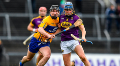 Ian Galvin of Clare and Wexford's Shane Reck battle for possession. Photo by Eóin Noonan/Sportsfile