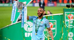 SHOOTOUT: Manchester City's Raheem Sterling lifts the trophy after his side's victory over Chelsea. Photo: PA