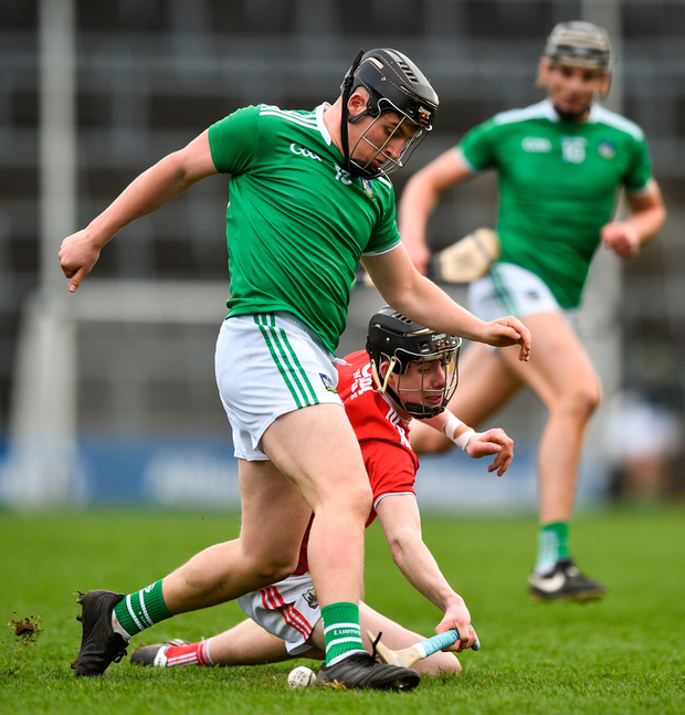 Peter Casey of Limerick in action against Robert Downey of Cork. Photo by David Fitzgerald/Sportsfile