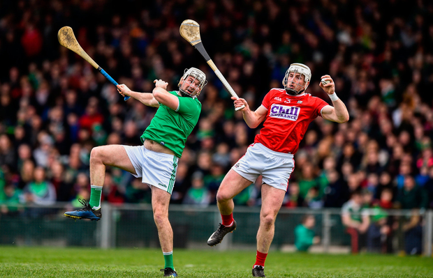 Patrick Horgan of Cork claims the ball ahead of Tom Condon of Limerick on his way to scoring his side's first goal. Photo by David Fitzgerald/Sportsfile