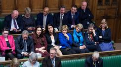 Heidi Allen (fifth right second row) sits next to Anna Soubry (fourth right) and Sarah Wollaston (third right) as they join the Independent Group of MPs on the back benches in the debating chamber in the House of Commons, London after they resigned from the Conservative Party. Photo: UK Parliament/Jessica Taylor/PA