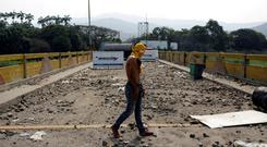 Clashes: A man on a cross-border bridge in Cucuta, Colombia, on the Venezuelan border, after the violence. Photo: REUTERS