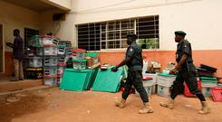 Police officers enter the INEC Yola North Local Government Area Office where Independent National Electoral Commission (INEC) officials collate results from various polling units, in Yola, Adamawa State, Nigeria. Photo: REUTERS/Nyancho NwaNri