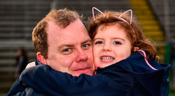 Cavan manager Mickey Graham gets a hug from his daughter Lauren (4). Photo by Seb Daly/Sportsfile