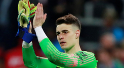 A dejected Kepa Arrizabalaga applauds the Chelsea supporters after the match at Wembley. Photo: Reuters
