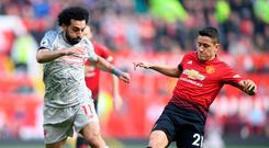Manchester United's Ander Herrera attempts to tackle Liverpool's Mohamed Salah