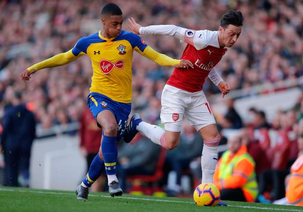 Arsenal's Mesut Ozil battles for possession with Southampton's Yan Valery. Photo: Getty Images