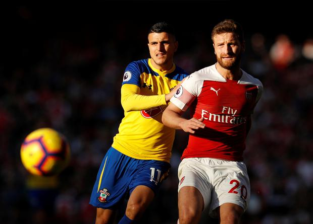 Southampton's Mohamed Elyounoussi in action with Arsenal's Shkodran Mustafi. Photo: Reuters
