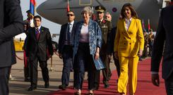 Welcome: British Prime Minister Theresa May is greeted by Nabila Makram, Egyptian Minister of Immigration, in Sharm El-Sheikh. Photo: Dan Kitwood/Getty