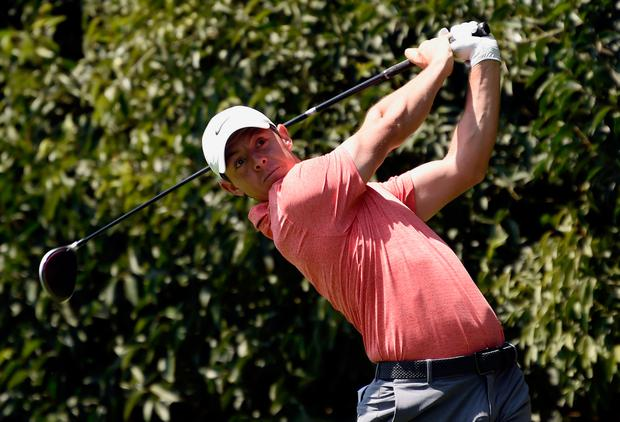 Rory McIlroy tees off at the second in the Mexico World Golf Championship yesterday. Photo: Getty Images