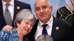 British Prime Minister Theresa May gets a hug from Bulgarian Prime Minister Boyko Borissov as she attends the EU-League of Arab States Summit in Sharm El-Sheikh, Egypt. Photo: Stefan Rousseau/PA Wire