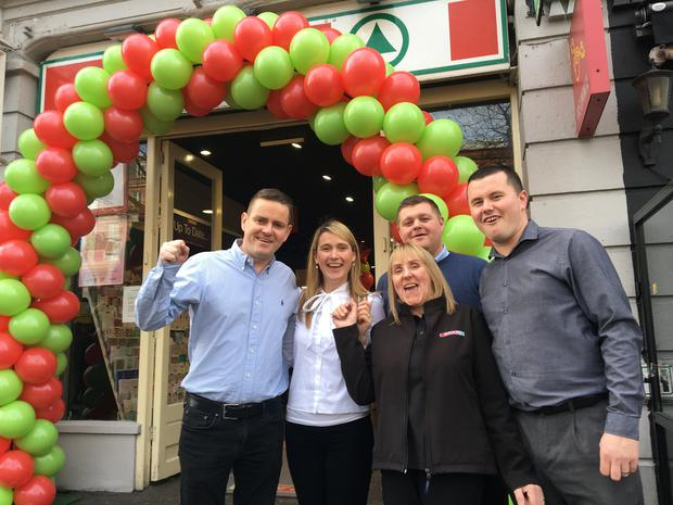 Manager Barry Thompson and his wife Jenny along with staff members at Spar O'Connell St which sold the winning €10 million lotto ticket