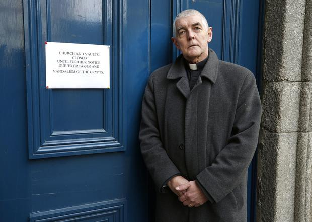 David Pierpoint, Archdeacon of Dublin beside a sign advising people the church and vaults are closed due to the the break in and vandalism of the Crypts in St Michans Church. Picture credit; Damien Eagers / INM
