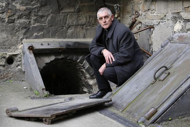 David Pierpoint, Archdeacon of Dublin beside the entrance to one of the Crypts in St Michans Church, which was broken into and vandalised. Picture credit; Damien Eagers / INM