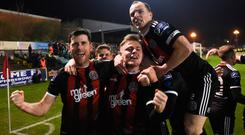 Dinny Corcoran celebrates after scoring his side's first goal with his Bohemians team-mates Conor Levingston, centre, and Derek Pender