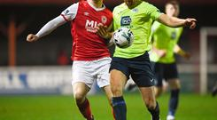 Gary Shaw of St Patrick's Athletic in action against Keith Cowan of Finn Harps