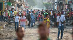 Hard border: Venezuelans wait for aid near the closed boundary with Colombia in the town of Urena. Photo: Getty Images