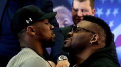 British boxer Anthony Joshua, left, and U.S. boxer Jarrell Miller pose head-to-head after giving a press conference at the Hilton London Syon Park hotel in London yesterday