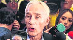 Detained: TV anchor Jorge Ramos speaks to reporters about his experience in Venezuela after arriving back in Miami yesterday. Photo: REUTERS/Maria Alejandra Cardona