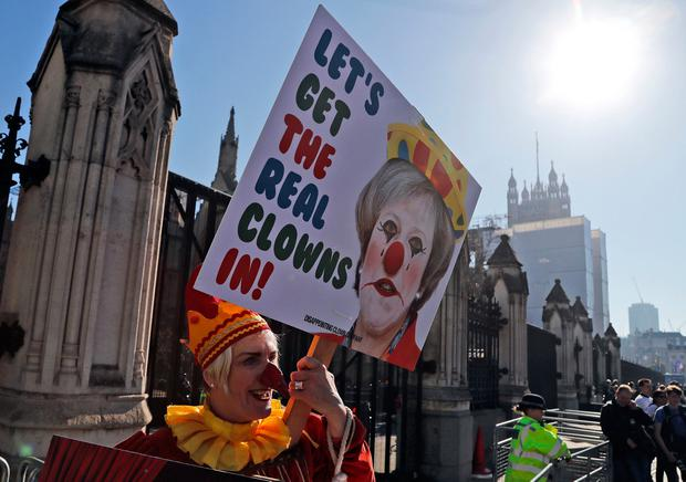 Anger: A demonstrator against Brexit protests at the entrance of the Houses of Parliament in London. AP photo
