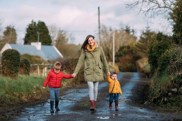 Nature walk: Jacinta Sheerin enjoys a stroll with her sons Adam (4) and Felix (2). Photo: Eamon Ward