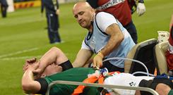 Dr Éanna Falvey attends to Paul O'Connell at the 2015 Rugby World Cup