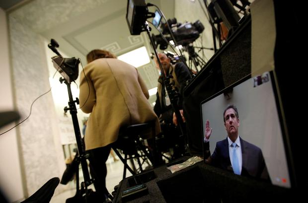 Michael Cohen, the former personal attorney of U.S. President Donald Trump, is show on a television monitor outside the hearing room as he is sworn in to testify before a House Committee on Oversight and Reform hearing on Capitol Hill in Washington, U.S., February 27, 2019. REUTERS/Carlos Barria