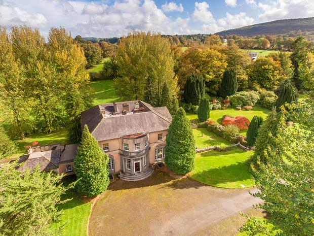 An aerial view of the period house which comes with 20 acres, a lodge and courtyard