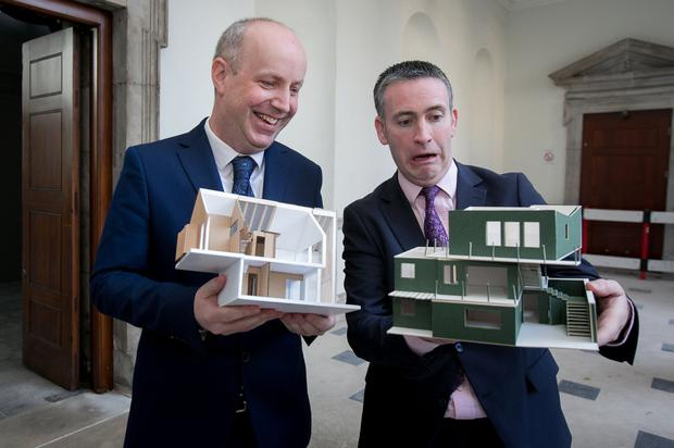 Blueprint: Junior Health Minister Jim Daly and Junior Housing Minister Damien English with models of houses which won an architecture competition sponsored by Age Friendly Ireland. Photo: Collins