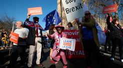 Joseph Afrane (centre) joins pro-Brexit and anti-Brexit demonstrators on Millbank, Westminster, London. Photo: PA