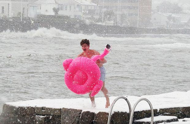 Keeping cool: One year ago a brave Liam Mulcahy took a dip at the Forty Foot, Sandycove, Dublin. Photo: Collins