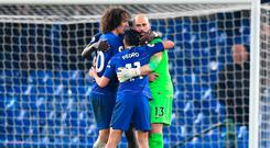 Chelsea goalkeeper Willy Caballero celebrates victory with David Luiz and Pedro. Photo: Getty