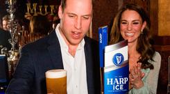 Britain's Prince William, Duke of Cambridge and Britain's Catherine, Duchess of Cambridge poor a pint of Harp Ice beer during their visit to the Empire Music Hall in Belfast, Northern Ireland on February 27, 2019. (Photo by Samir Hussein / POOL / AFP)