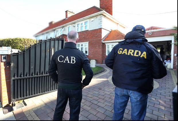 Gardai and CAB officers outside the confiscated Crumlin home of gangster Liam Byrne in 2016.