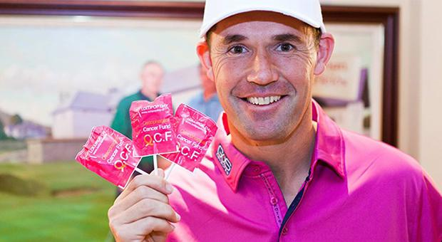 Oesophageal Cancer Fund patron Padraig Harrington with some campaign lollipops