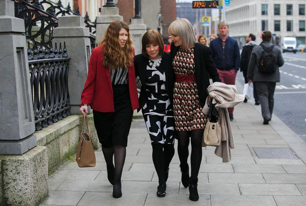 'Satisfactory': Clodagh Hawe's mother Mary Coll (centre) with daughter Jacqueline Connolly (right) and family friend Tamara Nolan after the meeting with Charlie Flanagan. Photo: Gareth Chaney, Collins