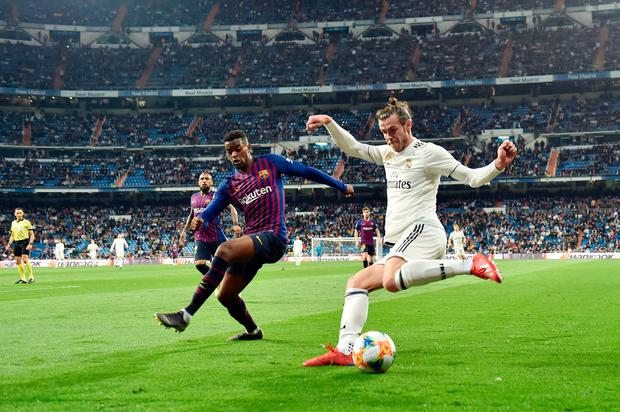 Gareth Bale in action for Real Madrid against Barcelona's Nelson Semedo after coming on as a substitute in their 3-0 defeat on Wednesday night. Photo: Getty Images
