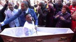 Pastor Alph Lukau (in blue beside the coffin) claims he brought his man back from the dead. PIC: Pastor Alph Lukau/Facebook